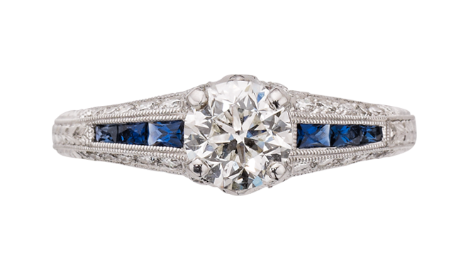 DL912 | 18ct White Gold. A Brilliant Cut Diamond (1.00ct, H/SI1) set Ring with Sapphire & Diamond inlaid Shoulders
