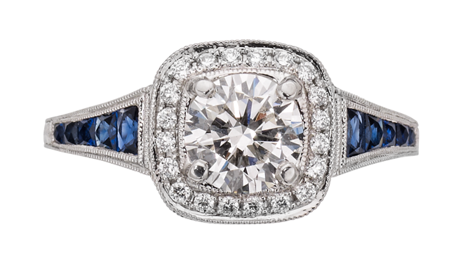 DN245 | Platinum. A Sapphire & Diamond set Ring with a Brilliant Cut Diamond (1.04cts, G/VS2) to Centre