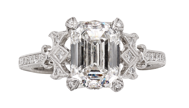 DN674 | Platinum. An Emerald Cut Diamond (3.00cts, F/VS2) set Ring with Diamond set Shoulders