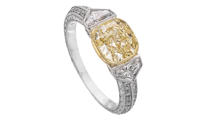 DR038 | Platinum & 18ct Gold. A Cushion Brilliant Cut Yellow Diamond (2.01cts) & Fancy Cut Diamond (0.59ct) set Ring with Diamond inlaid Shoulders (0.18ct)