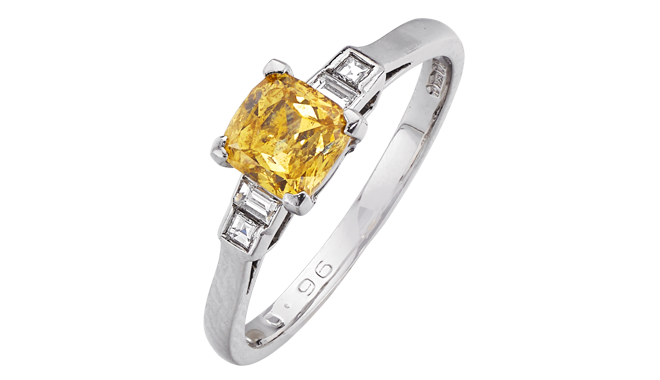 DB774 | Platinum. A Fancy Orange-yellow Diamond set Ring (0.96ct) with Diamond inlaid Shoulders
