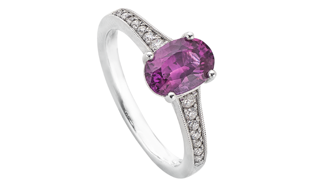 DT151 | Platinum. An Oval Cut Pink Sapphire & Diamond set Ring (S: 1.81cts, D: 0.18ct)