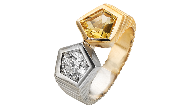 USS215 | European. 1940s. 18ct Gold & Platinum. A Yellow Sapphire & Diamond set Ring (S: 1.76cts, D: 0.78ct)